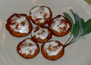 Pumpkin mini-muffins topped with organic frosting.