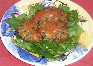 Millet Veggie Burgers on a bed of Romaine lettuce
